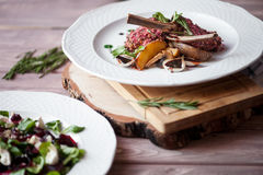 Rack of Lamb with mushrooms and roast potatoes Stock Images