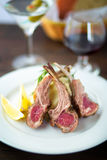 Rack of lamb. Rare cooked lamb rack fine dining Royalty Free Stock Photo