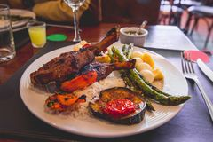 Rack of Lamb, rice and vegetables royalty free stock photo