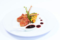 Rack of lamb with sauce and vegetables Royalty Free Stock Photos