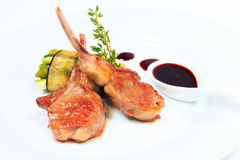 Rack of lamb with sauce and vegetables Stock Photography
