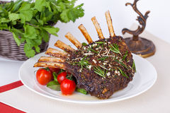 Rack of lamb with tomatoes Stock Photos