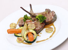 Rack of lamb with vegetables Stock Images