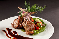 Rack of lamb with vegetables and sauce Stock Photos
