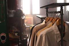 Male shirt fashion rack in store. A rack of male shirt in retail fashion store Stock Photography