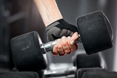 Rack with metal dumbbells in gym. Stock Photo