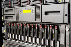 Rack mounted IT equipment. Rack mounted blade servers, system storage and tape library Royalty Free Stock Photography