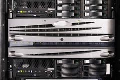 Rack mounted equipment. Rack mounted blade servers and system storage front view Stock Photo