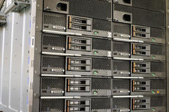 Rack mounted equipment. Rack mounted chassis with blade servers background Stock Image