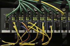 A rack of network gear. Media converters installed in a network rack Stock Image