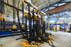 Rack with new cargo chain slings. Royalty Free Stock Images