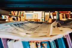 Rack with newspapers and old books. On the shelf of the newspaper and books. Rack with newspapers and old books. On the shelf of the newspaper and books stock photo