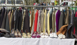 Rack of out of season jackets and shoes outdoors Royalty Free Stock Images