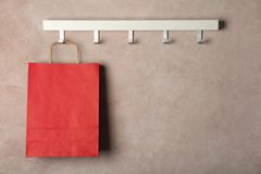 Rack with paper shopping bag. On color wall stock photos