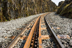 Rack and Pinion Through the Canyon. Rack and Pinion railway track passing through the canyon on the way up the mountain Stock Image