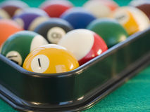 Rack of pool balls. Pool balls in a rack Royalty Free Stock Images