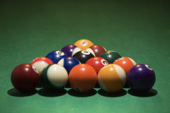 Rack of pool balls. Rack of pool balls on green billiards table Stock Images