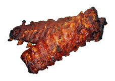 Rack Of Ribs. Two racks of cooked pork ribs isolated on white royalty free stock images