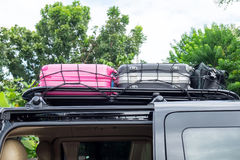 Rack on the roof van color luggage Royalty Free Stock Images