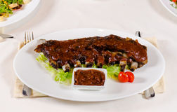 Rack of Saucy Barbecue Pork Ribs Royalty Free Stock Images