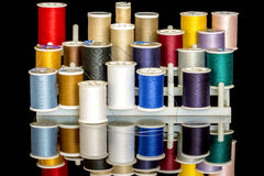 A rack of spools of colorful thread Royalty Free Stock Photography