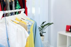 Rack with stylish clothes in boutique, closeup. Space for text stock photos