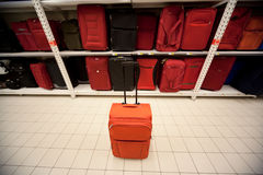 Rack with suitcases and one suitcase ahead Royalty Free Stock Photography
