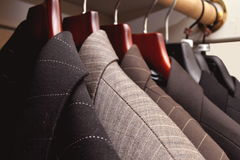 Rack of Suits. Rack of multi colored suites on a rack stock photos