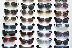 Rack with sunglasses in eyewear store Stock Image