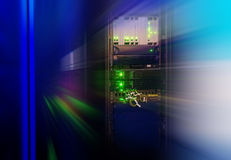 Rack with telecommunications network equipment in the data center with blur Royalty Free Stock Images