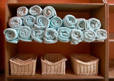 Rack with Towel. Rack with Rolled Up Towel and basket Royalty Free Stock Photos
