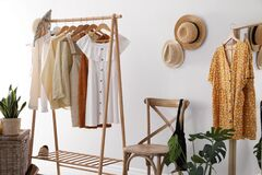 Free Rack With Stylish Women`s Clothes. Interior Design Stock Image - 183267511