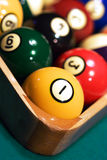 Racked billiard balls close up. Close up of Racked pool balls with the tight focus on a 1-ball Royalty Free Stock Photos