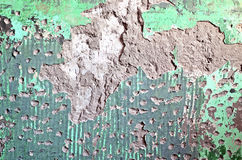 Сracked and chipped plaster paint on an wall. Texture of old plaster damaged brick or concrete wall. Grunge cracked concrete wall. Old vintage wall with plaster Royalty Free Stock Photo