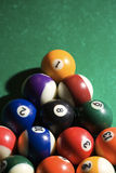 Racked Pool Balls. Cropped view of racked pool balls on a pool table. Vertical shot Stock Images