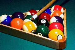 Racked pool balls, cue stick Stock Photo