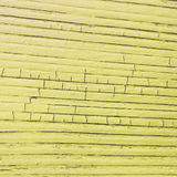 Racked wooden plank, yellow color. Cracked wooden plank, yellow  background Stock Image