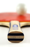 Racket. A red table tennis racket,shallow DoF Royalty Free Stock Photo