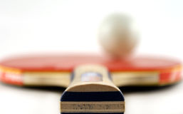 Racket. A red table tennis racket,shallow DoF Royalty Free Stock Photos