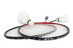 Racket is a badminton and shuttlecock. Rackets and shuttlecock with feathers on a white background Stock Photo