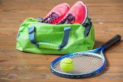Racket and ball for tennis in focus on the background of bag Stock Images