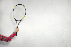Racket in person hand. Close up on hand with big tennis racket Stock Photo