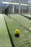 Racket sports ball. Ball in court, sun light net shadowd Royalty Free Stock Image