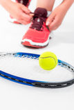 Racket and tennis ball closeup on white Royalty Free Stock Image