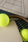 Racket and tennis balls Royalty Free Stock Photos