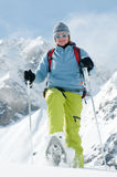 Racket trekking in snow Royalty Free Stock Photography