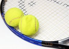 A racket and two tenis balls. Isolated racket and tennis balls Stock Photos