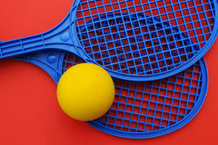 Rackets and ball. Two toy rackets and a ball royalty free stock photo