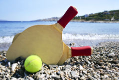 Rackets on the beach Royalty Free Stock Images