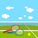 Rackets and tennis ball at tennis court Royalty Free Stock Images